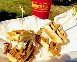 "<div class=""meta image-caption""><div class=""origin-logo origin-image none""><span>none</span></div><span class=""caption-text"">Miss Debbie's Specialty Apples - Chicken BBQ drenched with spicy buffalo sauce sandwiched between two warm, crisp waffle edges and topped with coleslaw. Served by Chick-N-Que (Credit: NC State Fair)</span></div>"