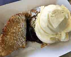 "<div class=""meta image-caption""><div class=""origin-logo origin-image none""><span>none</span></div><span class=""caption-text"">Deep Fried Chocolate Pie - Deep Fried Chocolate Pie served warm with vanilla ice cream. Served by Original Mineapple Pie near Kiddieland (Credit: NC State Fair)</span></div>"