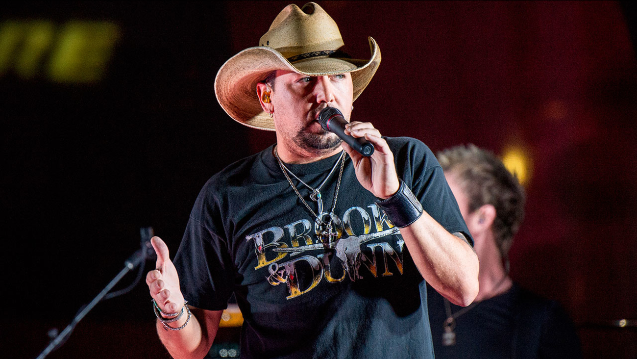 In this June 7, 2017 file photo Jason Aldean performs during a surprise pop up concert at the Music City Center in Nashville, Tenn.