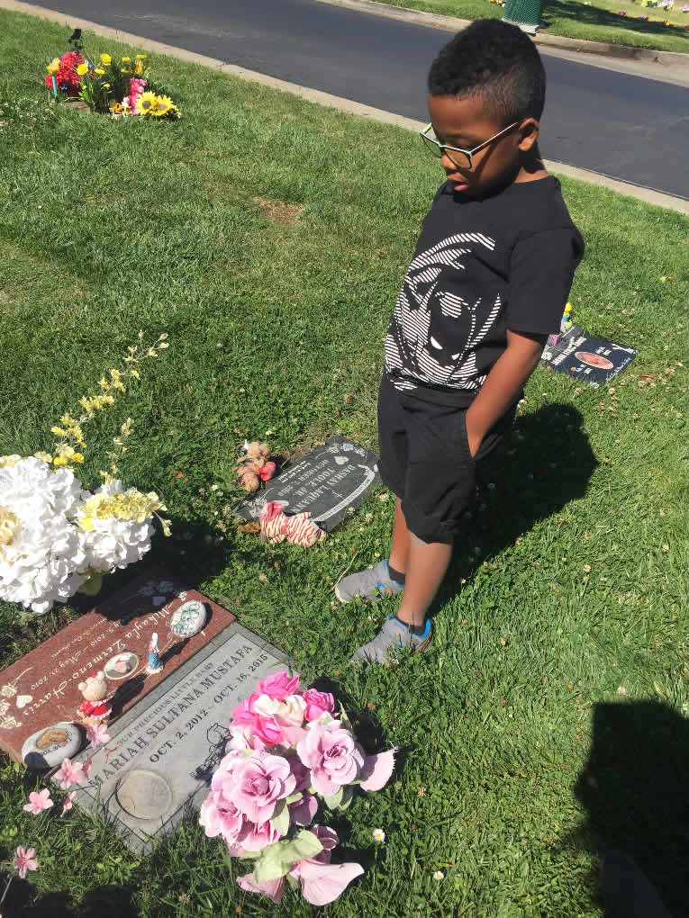 This undated image shows Jeremyah at a gravesite for his sister Mariah, who died in a Stockton, Calif. foster home in 2015 of alleged methamphetamine poisoning.
