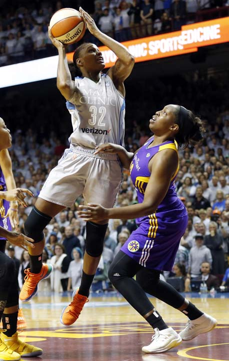 <div class='meta'><div class='origin-logo' data-origin='AP'></div><span class='caption-text' data-credit='Jim Mone)'>Minnesota Lynx's Rebekkah Brunson, left, shoots as Los Angeles Sparks' Chelsea Gray defends in the first half during Game 5 of the WNBA Finals Wednesday, Oct. 4, 2017.</span></div>