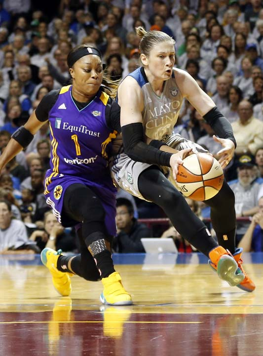 <div class='meta'><div class='origin-logo' data-origin='AP'></div><span class='caption-text' data-credit='Jim Mone)'>Los Angeles Sparks' Odyssey Sims, left, reaches in to knock the ball away from Minnesota Lynx's Lindsay Whalen in the first half during Game 5 of the WNBA Finals.</span></div>