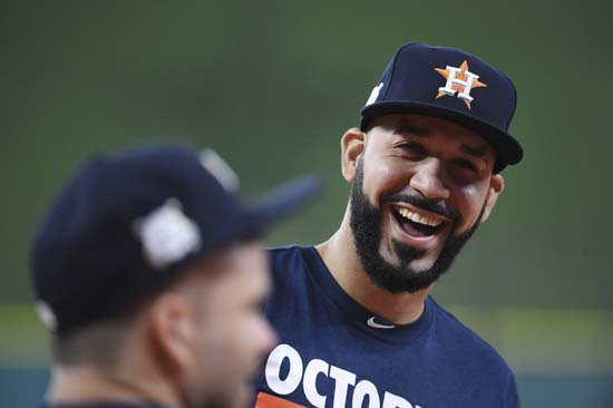 <div class='meta'><div class='origin-logo' data-origin='AP'></div><span class='caption-text' data-credit='Eric Christian Smith'>Houston Astros left fielder Marwin Gonzalez, right, jokes with teammate Jose Altuve before Game 1 of baseball's American League Division Series.</span></div>