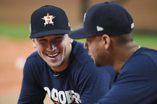 <div class='meta'><div class='origin-logo' data-origin='AP'></div><span class='caption-text' data-credit='Eric Christian Smith'>Houston Astros third baseman Alex Bregman, left, talks with teammate Yuli Gurriel, right, before Game 1 of baseball's American League Division Series.</span></div>