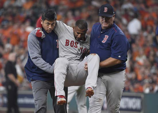 <div class='meta'><div class='origin-logo' data-origin='AP'></div><span class='caption-text' data-credit='Eric Christian Smith'>Boston Red Sox designated hitter Eduardo Nunez, center, is carried off the field after he was injured running to first base during the first inning in Game 1.</span></div>