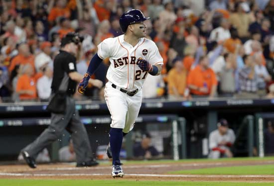 <div class='meta'><div class='origin-logo' data-origin='AP'></div><span class='caption-text' data-credit='Eric Christian Smith'>Houston Astros' Jose Altuve (27) watches his home run clear the fence during the first inning in Game 1 of baseball's American League Division Series.</span></div>