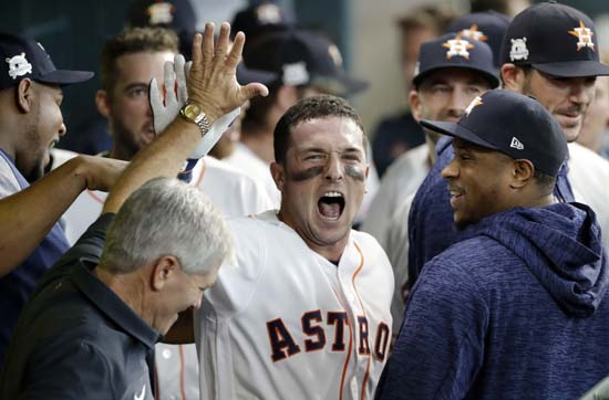 <div class='meta'><div class='origin-logo' data-origin='AP'></div><span class='caption-text' data-credit='David J. Phillip'>Houston Astros' Jose Altuve, center, celebrates his home run during the first inning in Game 1 of baseball's American League Division Series.</span></div>