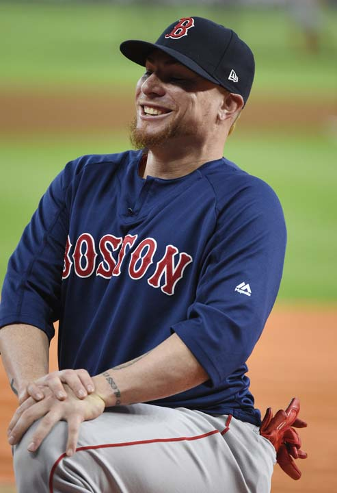 <div class='meta'><div class='origin-logo' data-origin='AP'></div><span class='caption-text' data-credit='Eric Christian Smith'>Boston Red Sox catcher Christian Vazquez stretches before Game 1 of baseball's American League Division Series.</span></div>