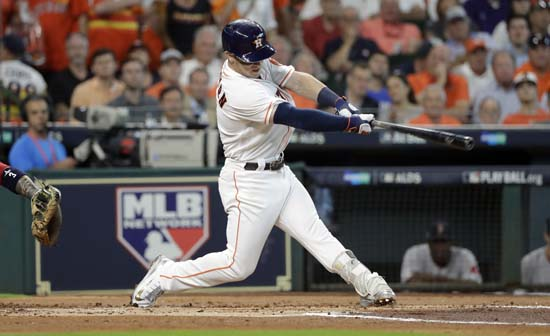 <div class='meta'><div class='origin-logo' data-origin='AP'></div><span class='caption-text' data-credit='David J. Phillip'>Houston Astros's Alex Bregman hits a solo homer against the Boston Red Sox during the first inning in Game 1 of baseball's American League Division Series.</span></div>