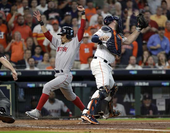 <div class='meta'><div class='origin-logo' data-origin='AP'></div><span class='caption-text' data-credit='David J. Phillip'>Boston Red Sox's Mookie Betts, left, scores past Houston Astros catcher Brian McCann during the fourth inning in Game 1.</span></div>