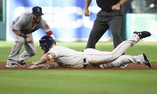<div class='meta'><div class='origin-logo' data-origin='AP'></div><span class='caption-text' data-credit='Eric Christian Smith'>Houston Astros' Evan Gattis is safe at second base on a double as Boston Red Sox second baseman Dustin Pedroia (15) is late with the tag during the fourth inning in Game 1.</span></div>