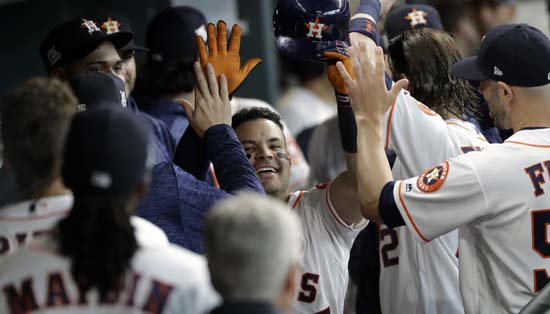 <div class='meta'><div class='origin-logo' data-origin='AP'></div><span class='caption-text' data-credit='David J. Phillip'>Houston Astros' Jose Altuve, center, celebrates his home run against the Boston Red Sox during the fifth inning in Game 1 of a baseball American League Division Series.</span></div>