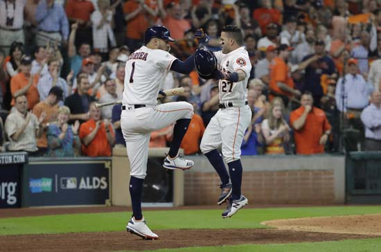 <div class='meta'><div class='origin-logo' data-origin='AP'></div><span class='caption-text' data-credit='David J. Phillip'>Houston Astros' Jose Altuve, right, celebrates his home run against the Boston Red Sox with Carlos Correa (1) during the fifth inning in Game 1.</span></div>
