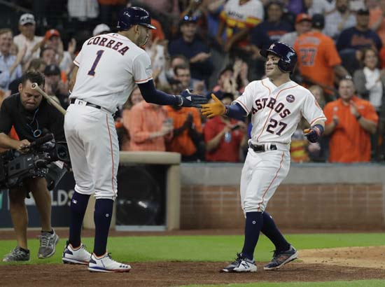 <div class='meta'><div class='origin-logo' data-origin='AP'></div><span class='caption-text' data-credit='David J. Phillip'>Houston Astros' Jose Altuve (27) celebrates his solo home run, his third of the game, against the Boston Red Sox with teammate Carlos Correa (1) in the seventh inning in Game 1.</span></div>