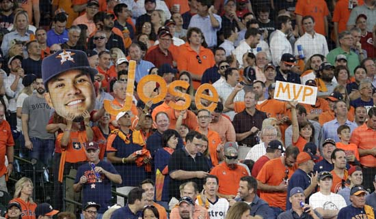 <div class='meta'><div class='origin-logo' data-origin='AP'></div><span class='caption-text' data-credit='David J. Phillip'>Fan show their support of Houston Astros' Jose Altuve after he hit his third home run of the day against the Boston Red Sox, during the seventh in Game 1.</span></div>