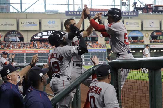 <div class='meta'><div class='origin-logo' data-origin='AP'></div><span class='caption-text' data-credit='Eric Christian Smith'>Boston Red Sox's Mookie Betts, right, celebrates with teammates at the dugout steps after he scored against the Houston Astros in the fourth inning in Game 1.</span></div>
