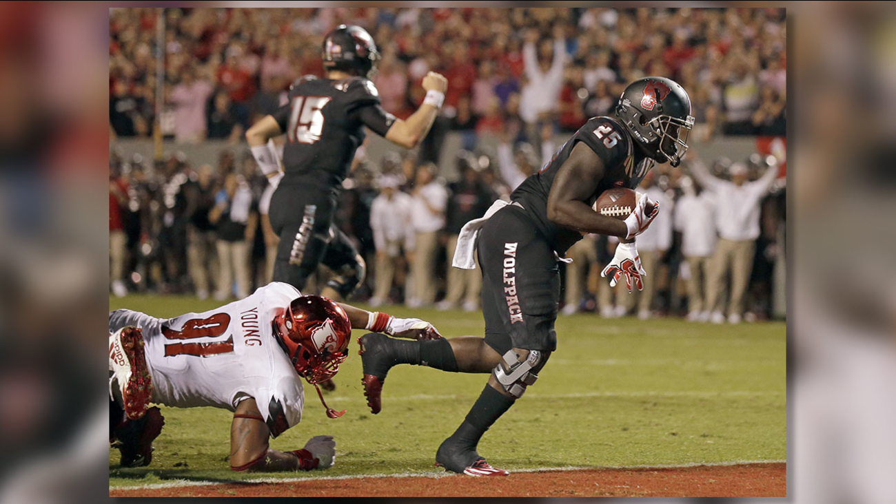 NC State's Reggie Gallaspy II scores a touchdown during the second half of the Wolfpack's win over Louisville.