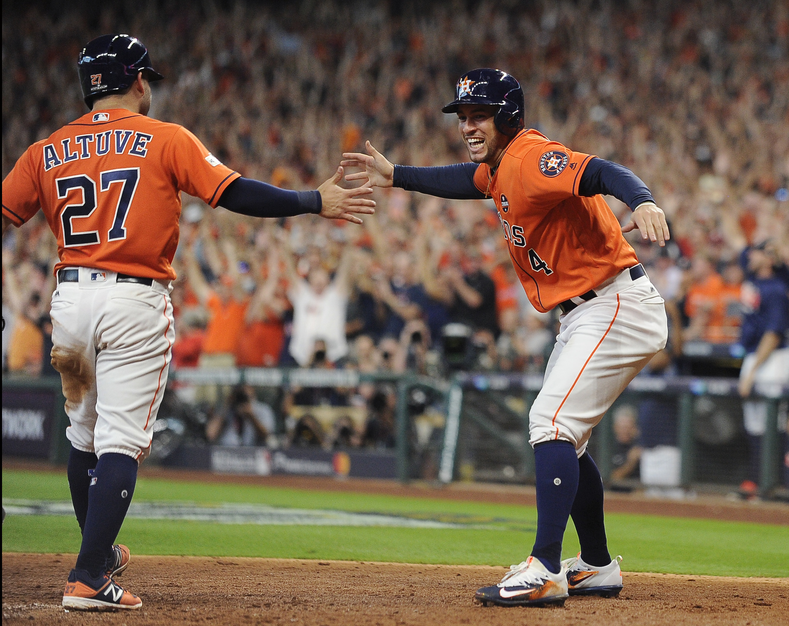 <div class='meta'><div class='origin-logo' data-origin='AP'></div><span class='caption-text' data-credit='Eric Christian Smith'>Houston Astros' Jose Altuve (27) and George Springer (4) celebrate after they scored on teammate Carlos Correa's double in Game 2.</span></div>