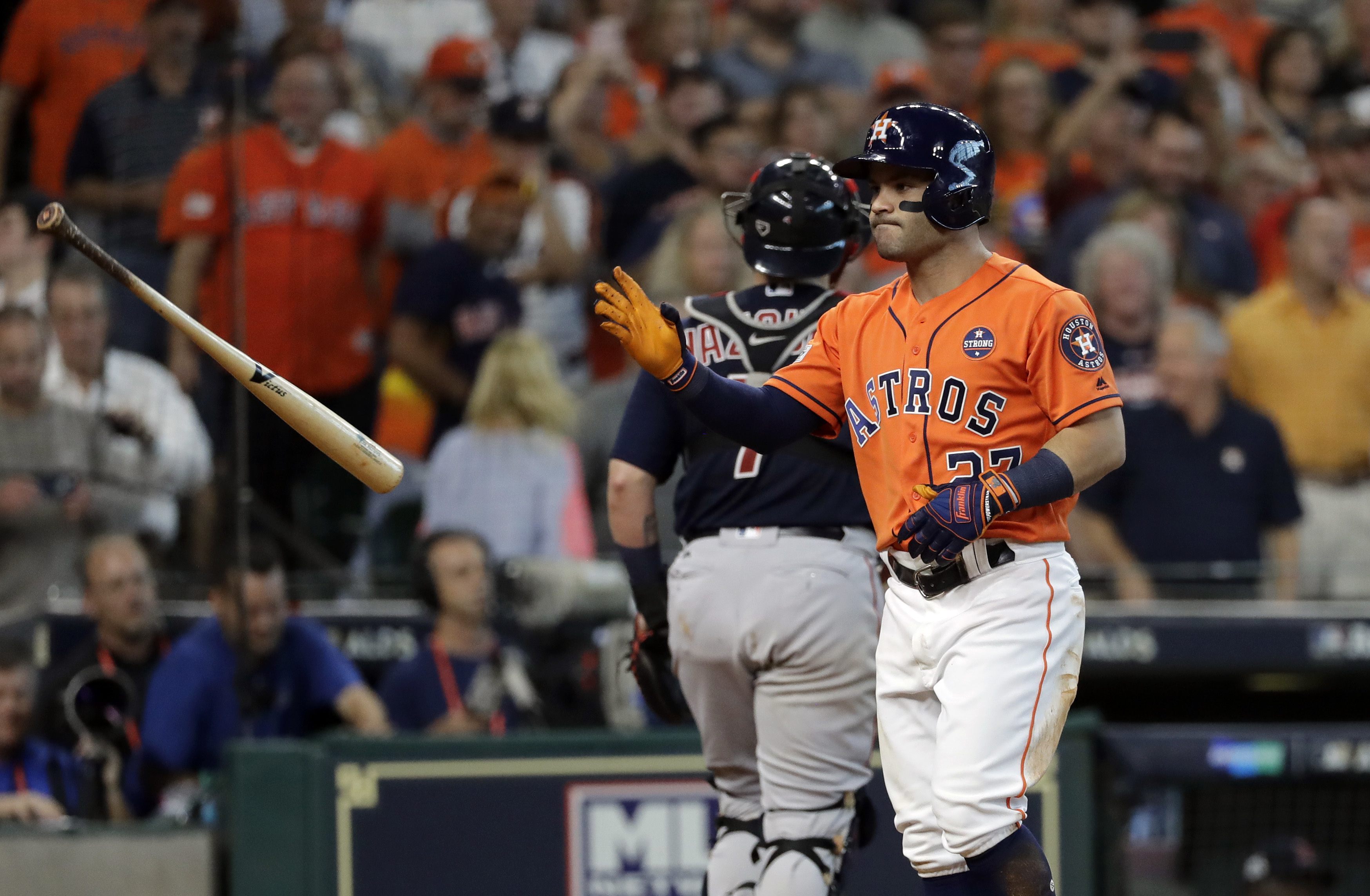 <div class='meta'><div class='origin-logo' data-origin='AP'></div><span class='caption-text' data-credit='David J. Phillip'>Houston Astros' Jose Altuve (27) tosses his bat after he struck out with the bases loaded during the seventh inning in Game 2.</span></div>