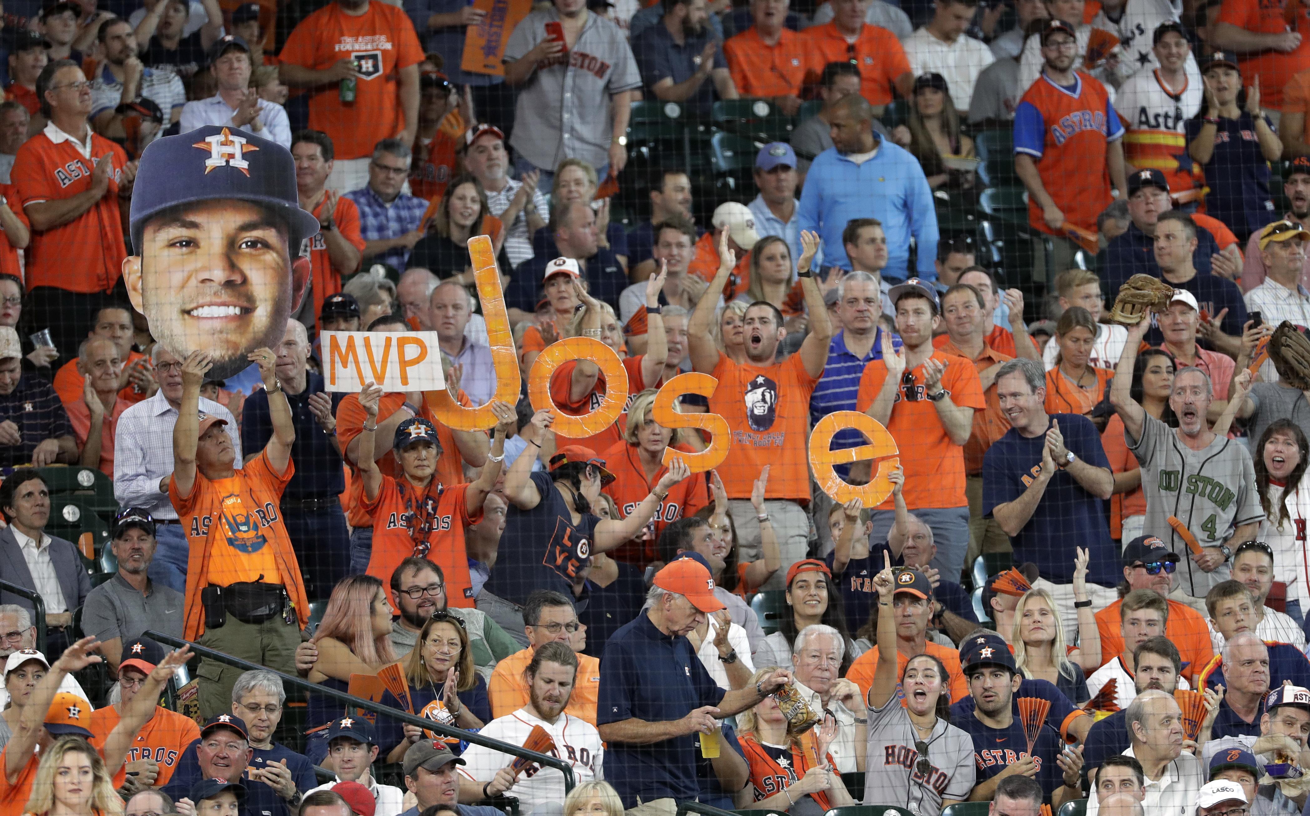 <div class='meta'><div class='origin-logo' data-origin='AP'></div><span class='caption-text' data-credit='David J. Phillip'>Fans cheer for Houston Astros second baseman Jose Altuve (27) during the first inning in Game 2.</span></div>