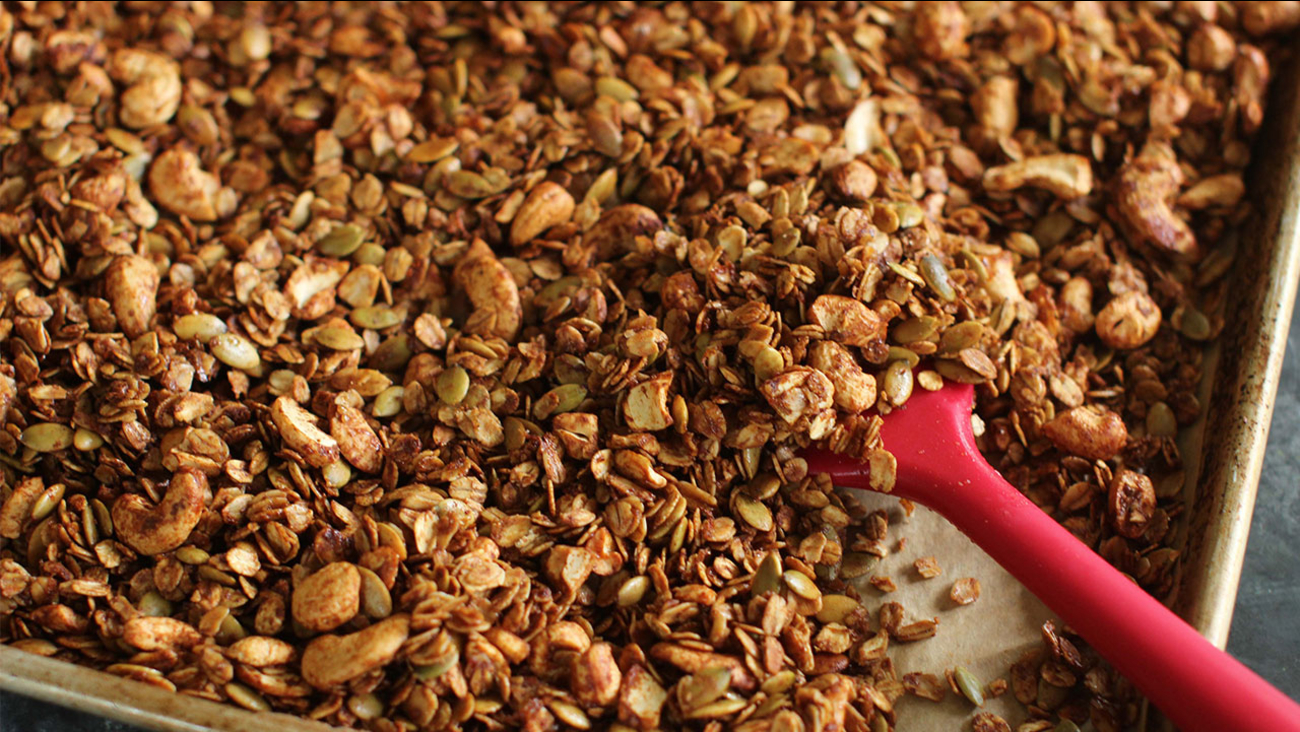 This June 15, 2015 photo shows cinnamon citrus granola with pepitas and cashews.