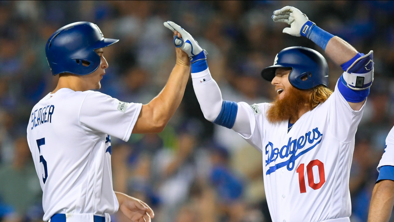 Los Angeles Dodgers' Justin Turner, right, celebrates his three-run home run with Corey Seager during Game 1 of NLDS against the Arizona Diamondbacks on Friday, Oct. 6, 2017.