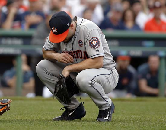 <div class='meta'><div class='origin-logo' data-origin='AP'></div><span class='caption-text' data-credit='Michael Dwyer'>Houston Astros relief pitcher Lance McCullers Jr., crouches during the fourth inning in Game 3 of baseball's American League Division Series against the Boston Red Sox</span></div>