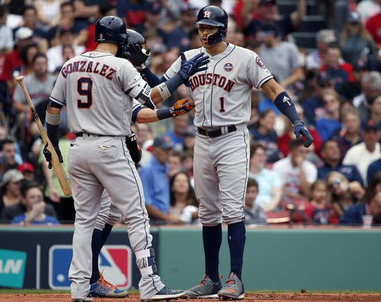 <div class='meta'><div class='origin-logo' data-origin='AP'></div><span class='caption-text' data-credit='Michael Dwyer'>Houston Astros's Carlos Correa, right, celebrates his two-run home run off Boston Red Sox starting pitcher Doug Fister with Marwin Gonzalez (9) and Josh Reddick.</span></div>