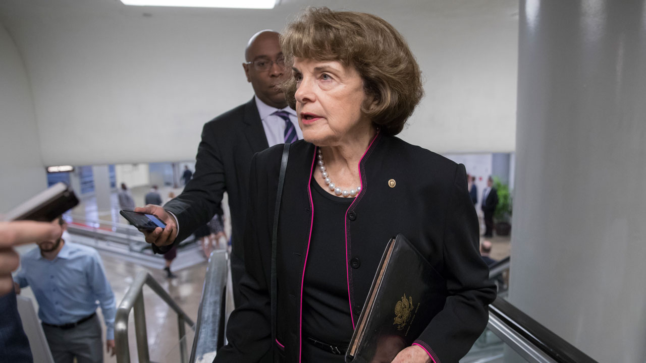 Sen. Dianne Feinstein, D-Calif., speaks to reporters as she arrives at the Capitol in Washington, Tuesday, Sept. 19, 2017.