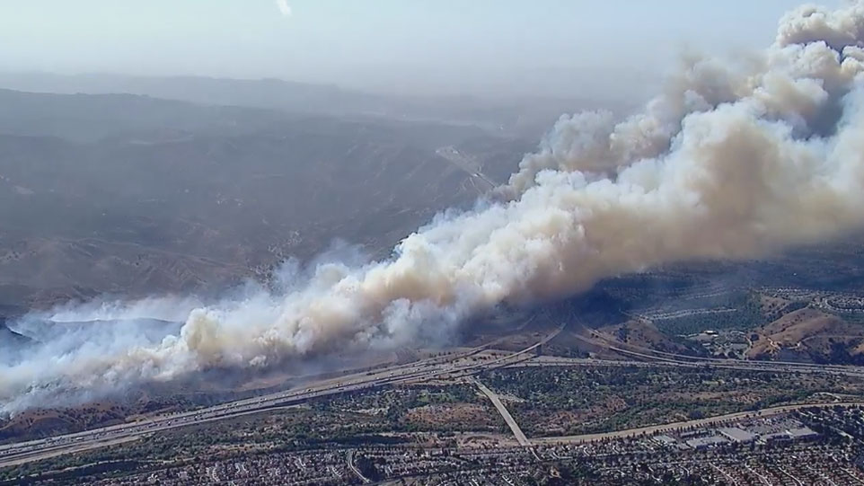 <div class='meta'><div class='origin-logo' data-origin='KABC'></div><span class='caption-text' data-credit=''>The Anaheim Fire and Rescue Department said the blaze, which has been dubbed the Canyon Fire 2, quickly spread Monday, triggering evacuations in the Anaheim Hills area.</span></div>