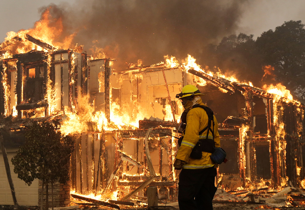 <div class='meta'><div class='origin-logo' data-origin='none'></div><span class='caption-text' data-credit='Jeff Chiu/AP Photo'>A firefighter monitors a house burning in Santa Rosa, Calif., Monday, Oct. 9, 2017.</span></div>