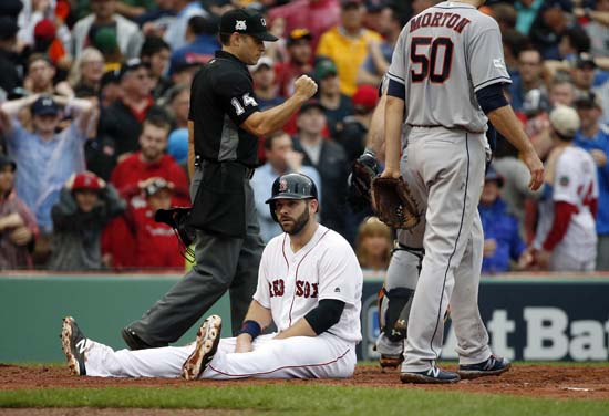 <div class='meta'><div class='origin-logo' data-origin='AP'></div><span class='caption-text' data-credit='AP'>Boston Red Sox's Mitch Moreland, seated, is called out at home during the third inning in Game 4. (AP Photo/Michael Dwyer)</span></div>
