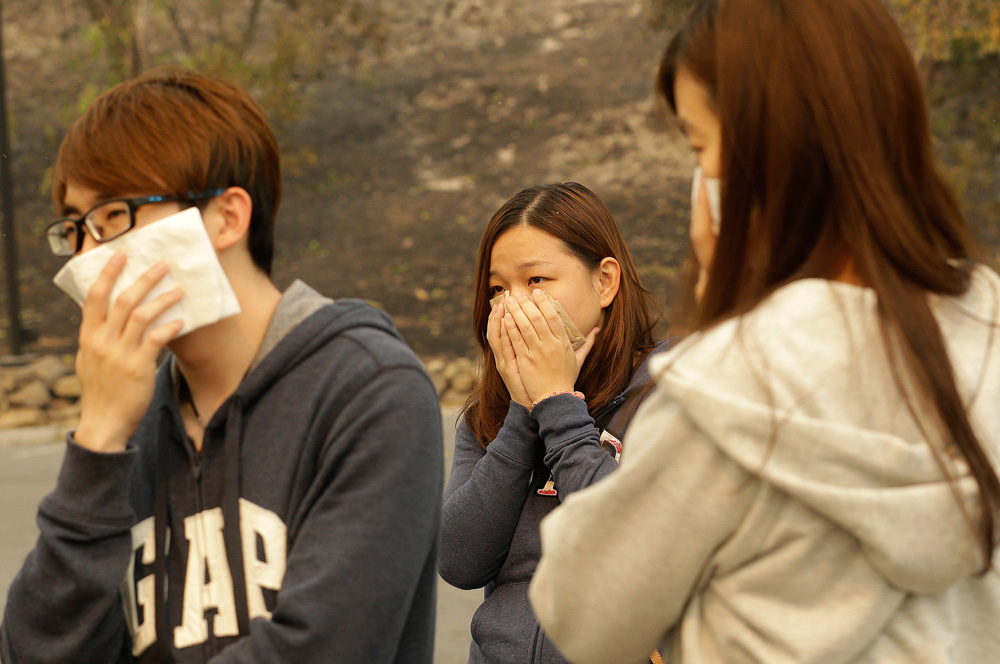 <div class='meta'><div class='origin-logo' data-origin='none'></div><span class='caption-text' data-credit='Jeff Chiu/AP Photo'>Vincent Yeoh, from left, Ai Peng, Estella Fong, all from Malaysia, cover their mouths from smoke coming from a burning Hilton Sonoma Wine Country hotel, where they were all staying</span></div>