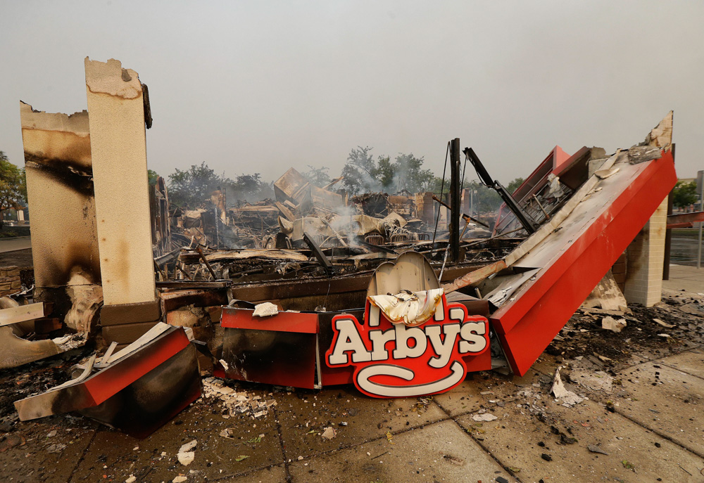 "<div class=""meta image-caption""><div class=""origin-logo origin-image none""><span>none</span></div><span class=""caption-text"">Smoke rises from an Arby's Restaurant that was destroyed by a wildfire in Santa Rosa, Calif., Monday, Oct. 9, 2017. (Jeff Chiu/AP Photo)</span></div>"