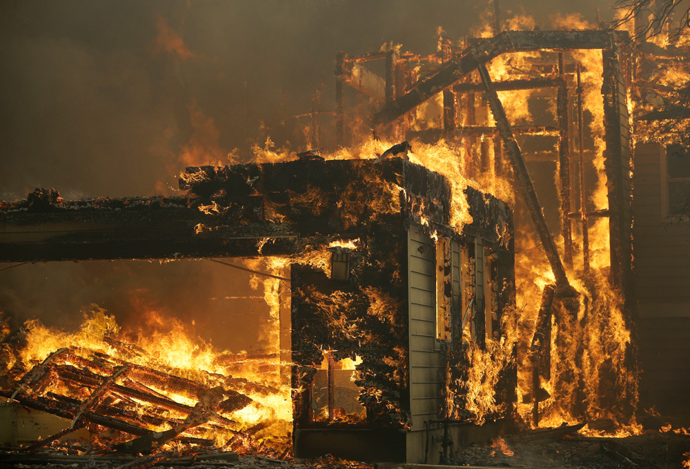 <div class='meta'><div class='origin-logo' data-origin='none'></div><span class='caption-text' data-credit='Jeff Chiu/AP Photo'>A house burns in Santa Rosa, Calif., Monday, Oct. 9, 2017.</span></div>