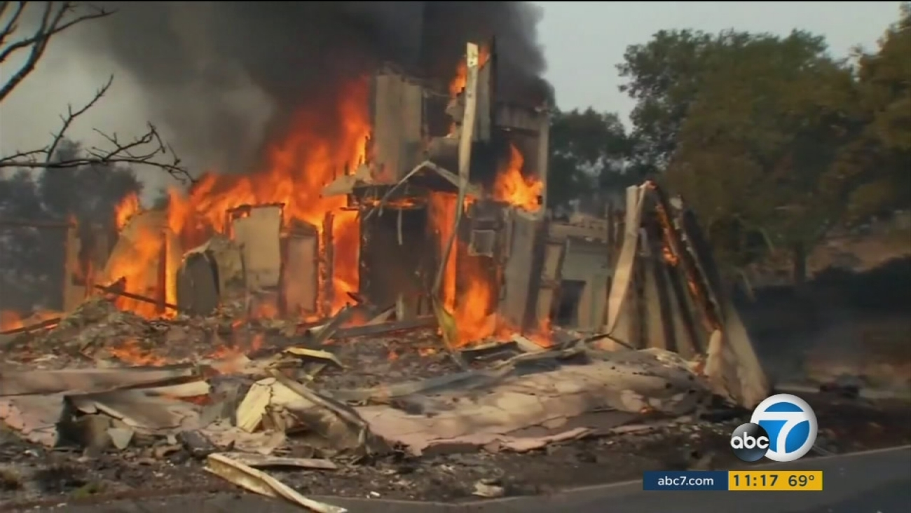 A home is seen engulfed in flames during the Northern California wildfires on Monday, Oct. 9, 2017.