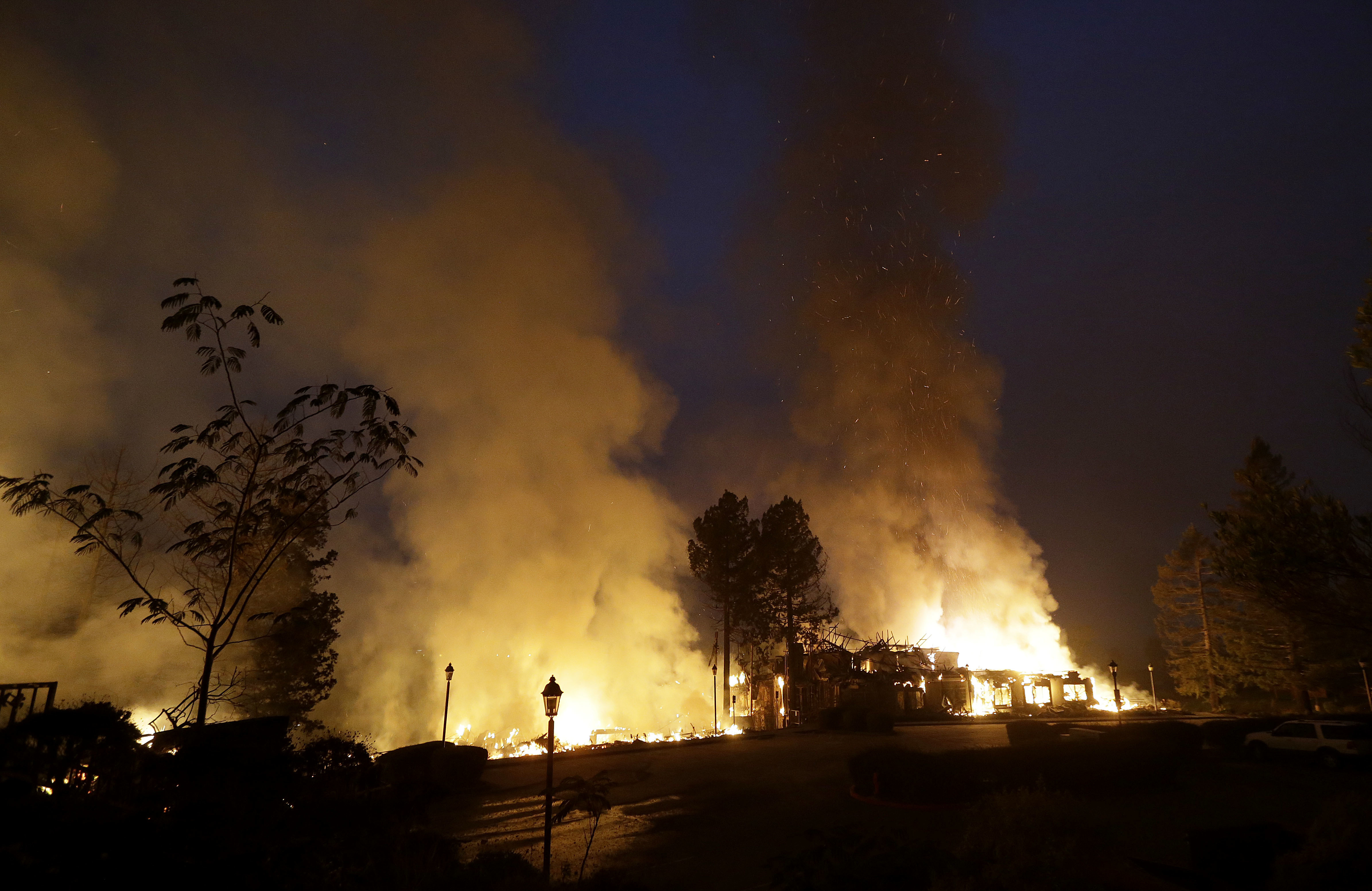 <div class='meta'><div class='origin-logo' data-origin='none'></div><span class='caption-text' data-credit='Jeff Chiu/AP Photo'>Smoke and flames from fire at the Hilton Sonoma Wine Country hotel in Santa Rosa, Calif., Monday, Oct. 9, 2017.</span></div>
