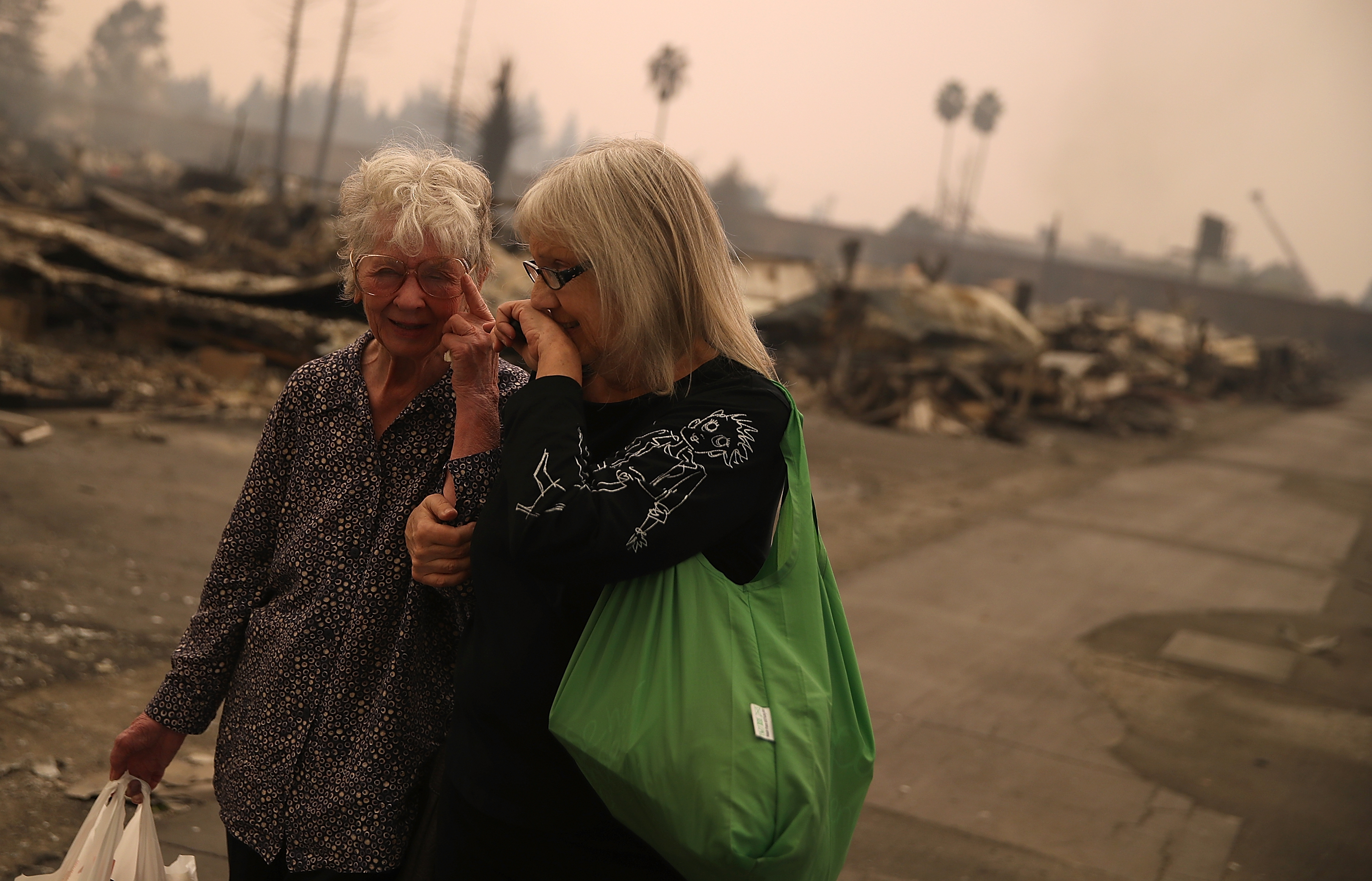 "<div class=""meta image-caption""><div class=""origin-logo origin-image none""><span>none</span></div><span class=""caption-text"">Residents walk through the fire damaged Journey's End Mobile Home Park on October 9, 2017 in Santa Rosa, California. (Justin Sullivan/Getty Images)</span></div>"