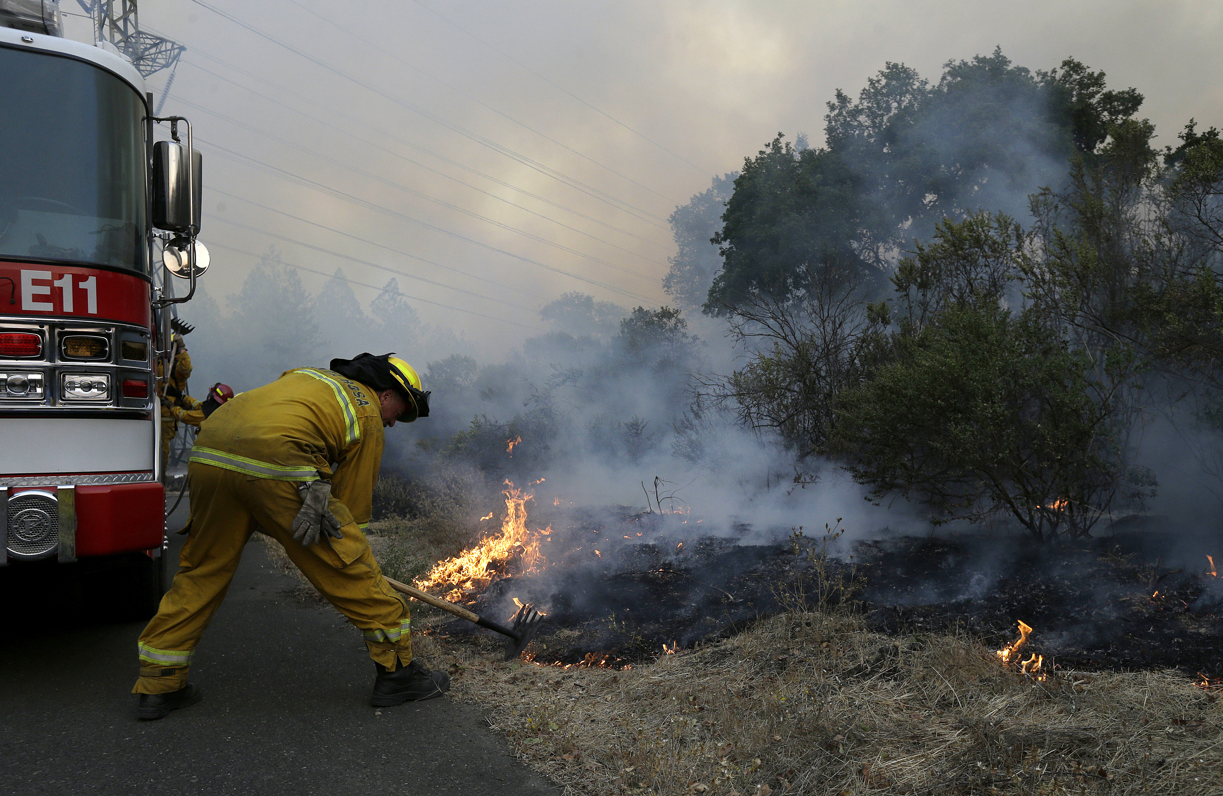 <div class='meta'><div class='origin-logo' data-origin='none'></div><span class='caption-text' data-credit='Jeff Chiu/AP Photo'>Santa Rosa firefighters work on a fire on the side of a road near the Oakmont area in Santa Rosa, Calif., Tuesday, Oct. 10, 2017.</span></div>