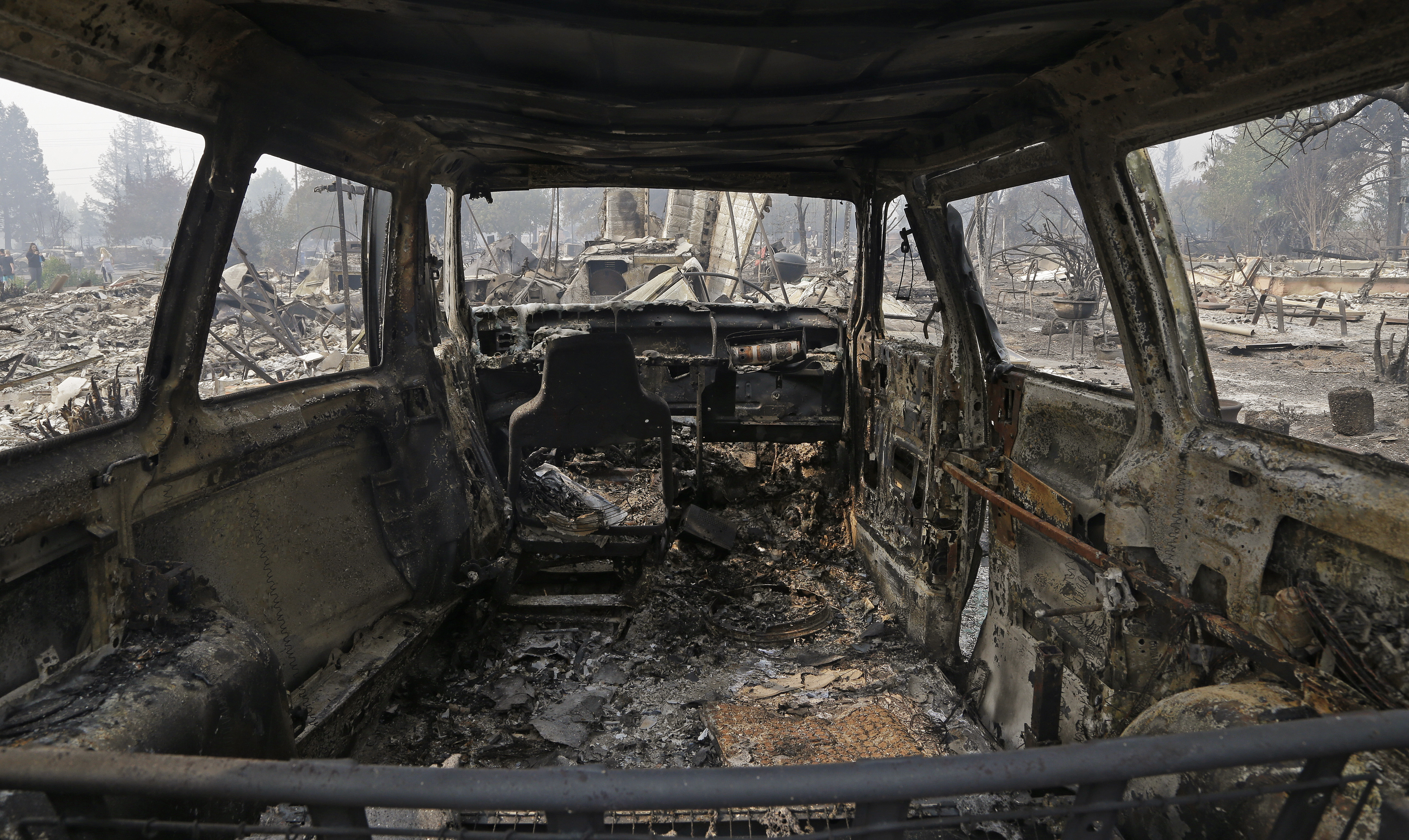 <div class='meta'><div class='origin-logo' data-origin='none'></div><span class='caption-text' data-credit='Ben Margot/AP Photo'>View from inside a parked car destroyed by fire in the Coffey Park area of Santa Rosa, Calif., on Tuesday, Oct. 10, 2017.</span></div>