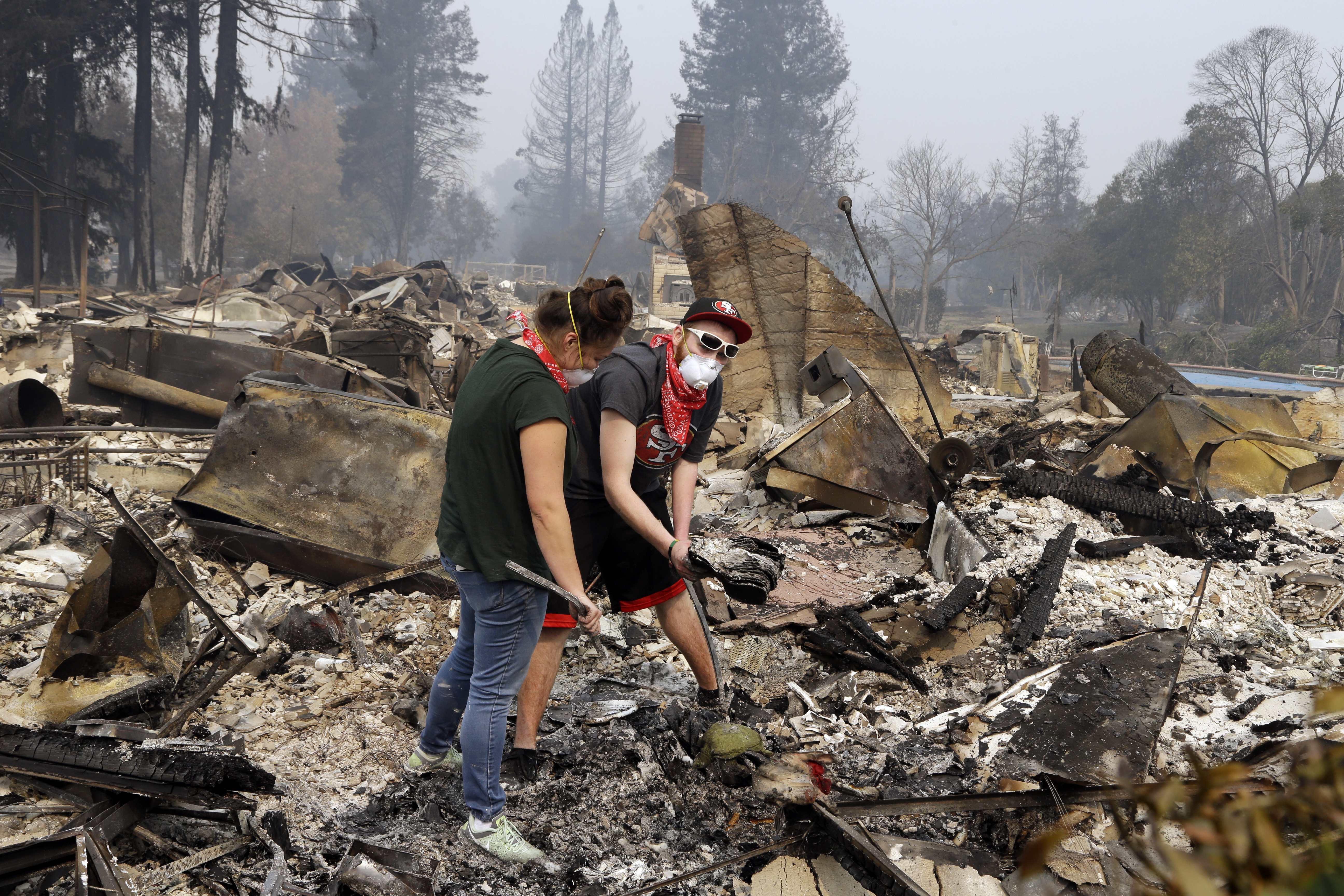 <div class='meta'><div class='origin-logo' data-origin='none'></div><span class='caption-text' data-credit='Ben Margot/AP Photo'>Robyn and Daniel Pellegrini search for belongings in the ashes of their home that was destroyed by fire in the Coffey Park area of Santa Rosa, Calif., on Tuesday, Oct. 10, 2017.</span></div>