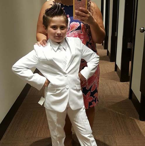 <div class='meta'><div class='origin-logo' data-origin='none'></div><span class='caption-text' data-credit='Chris Mansell/Facebook'>An Indiana girl who was banned from wearing a pantsuit to her First Holy Communion is getting support after her mom's Facebook post went viral.</span></div>