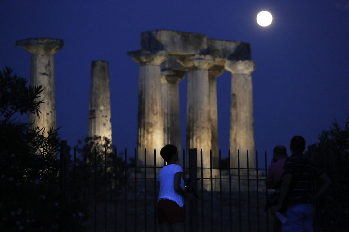 "<div class=""meta image-caption""><div class=""origin-logo origin-image ""><span></span></div><span class=""caption-text"">The super moon rises in the sky in front of the Apollo's temple at ancient Corinth, about 80 kilometers (50 miles) southwest of Athens, Sunday, Aug. 10, 2014. (AP Photo/Petros Giannakouris)</span></div>"