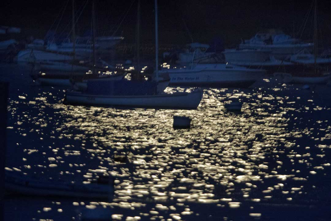 "<div class=""meta image-caption""><div class=""origin-logo origin-image ""><span></span></div><span class=""caption-text"">The moon is reflected as yellow sparks upon a darkening harbor in Edgartown, Mass., Sunday, Aug. 10, 2014, on the island of Martha's Vineyard. (AP Photo/Jacquelyn Martin)</span></div>"