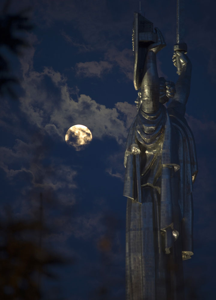 "<div class=""meta image-caption""><div class=""origin-logo origin-image ""><span></span></div><span class=""caption-text"">The supermoon rises through the clouds behind the ''Motherland'' statue, part of the WWII memorial complex, in Kiev, Ukraine, Sunday, Aug. 10, 2014. (AP Photo/Osman Karimov)</span></div>"