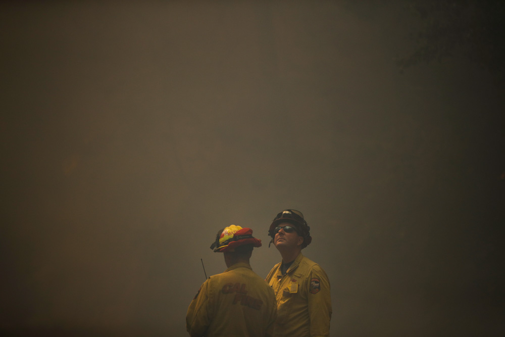 "<div class=""meta image-caption""><div class=""origin-logo origin-image none""><span>none</span></div><span class=""caption-text"">Two firefighters look on as think smoke from a wildfire fills the air along the Highway 29 Thursday, Oct. 12, 2017, near Calistoga, Calif. (Jae C. Hong/AP Photo)</span></div>"