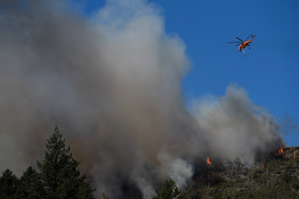 <div class='meta'><div class='origin-logo' data-origin='none'></div><span class='caption-text' data-credit='Jae C. Hong/AP Photo'>A helicopter flies over a wildfire Thursday, Oct. 12, 2017, near Calistoga, Calif.</span></div>