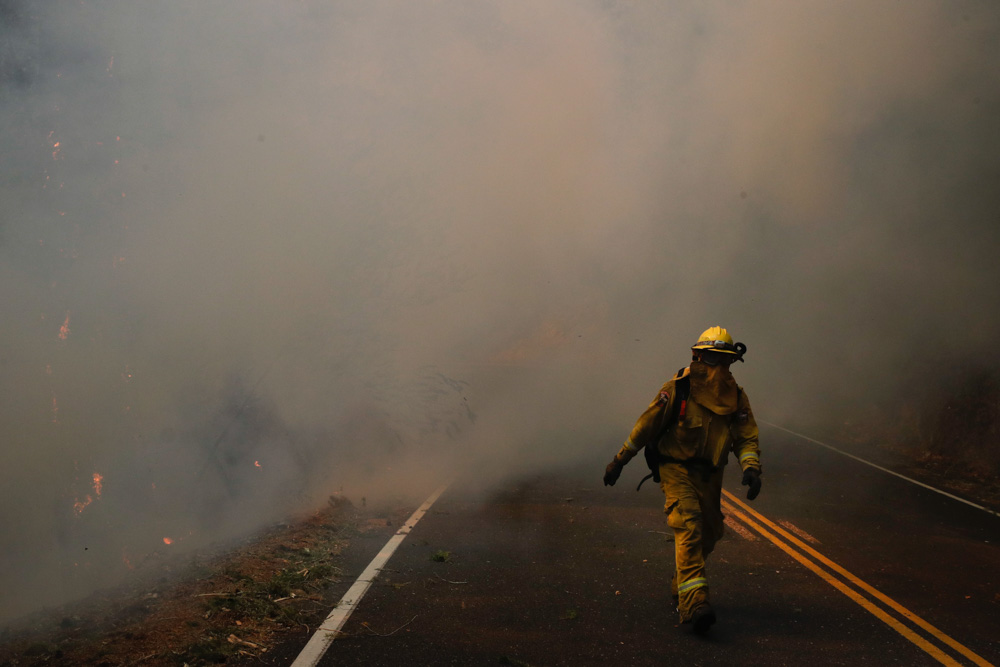 <div class='meta'><div class='origin-logo' data-origin='none'></div><span class='caption-text' data-credit='Jae C. Hong/AP Photo'>A firefighter walks along the Highway 29 as thick smoke from a wildfire fills the air Thursday, Oct. 12, 2017, near Calistoga, Calif.</span></div>