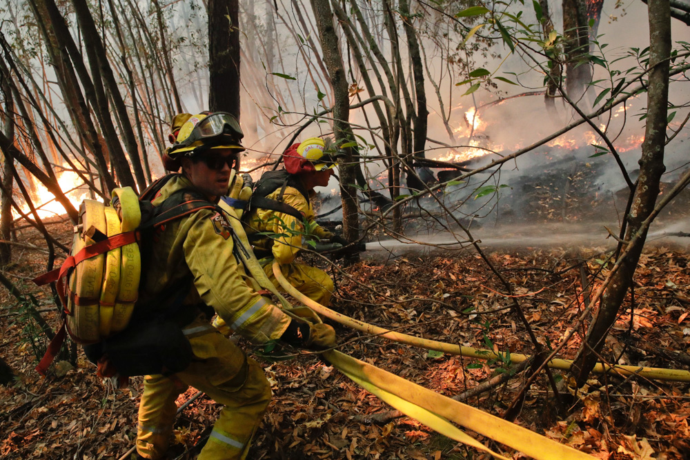 <div class='meta'><div class='origin-logo' data-origin='none'></div><span class='caption-text' data-credit='Jae C. Hong/AP Photo'>Firefighters put out a hot spot from a wildfire Thursday, Oct. 12, 2017, near Calistoga, Calif.</span></div>