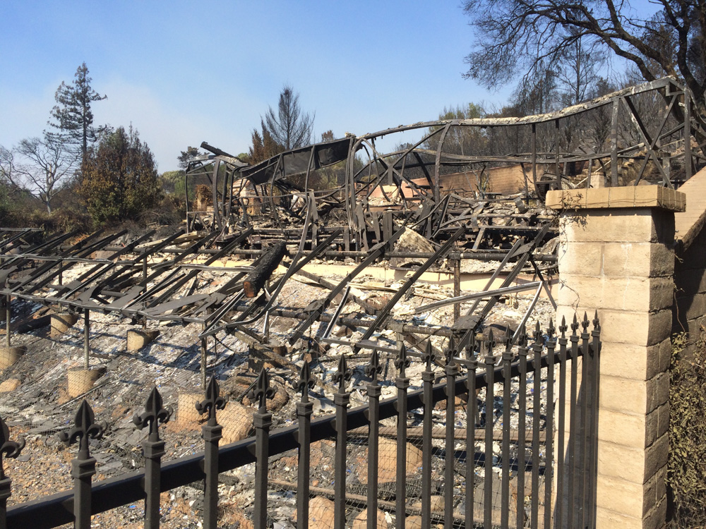 <div class='meta'><div class='origin-logo' data-origin='none'></div><span class='caption-text' data-credit='Dean Smith'>Every house on Crystal Drive and Heights Road in Santa Rosa, Calif. has burned.</span></div>
